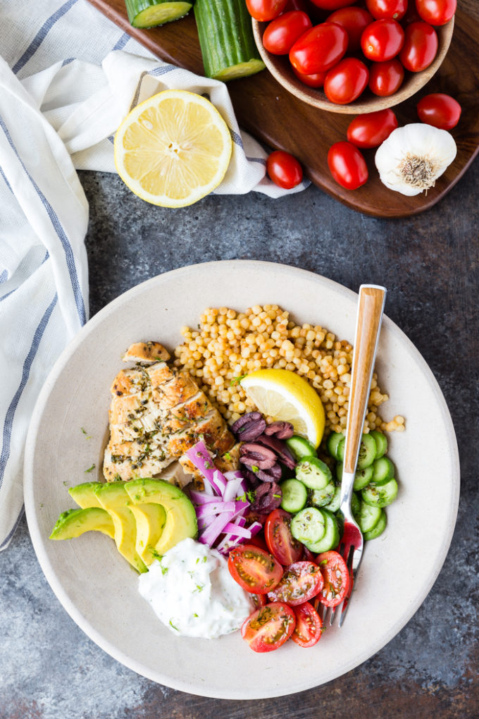 A lovely greek chicken bowl with Kalamata olives, avocado, tomato, cucumber and more.