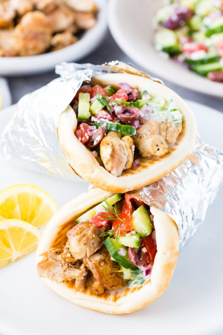 Greek Chicken Gyros cooked in the Instant Pot pressure cooker, and layered with homemade tzatziki and Greek salad