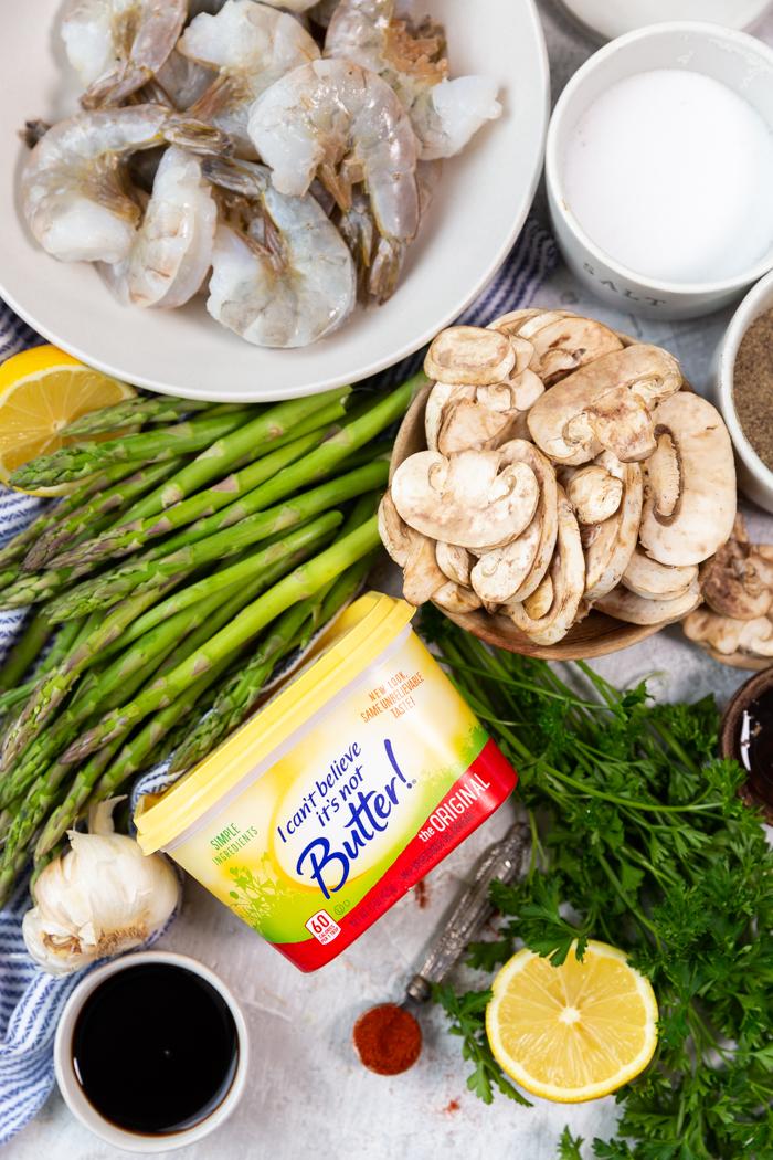 All the ingredients needed to make sheet pan honey garlic lemon shrimp