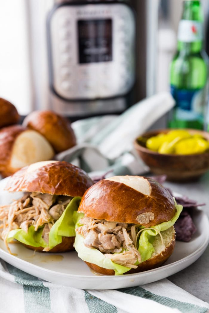 Instant Pot Mississippi Chicken made into sliders with pretzel buns