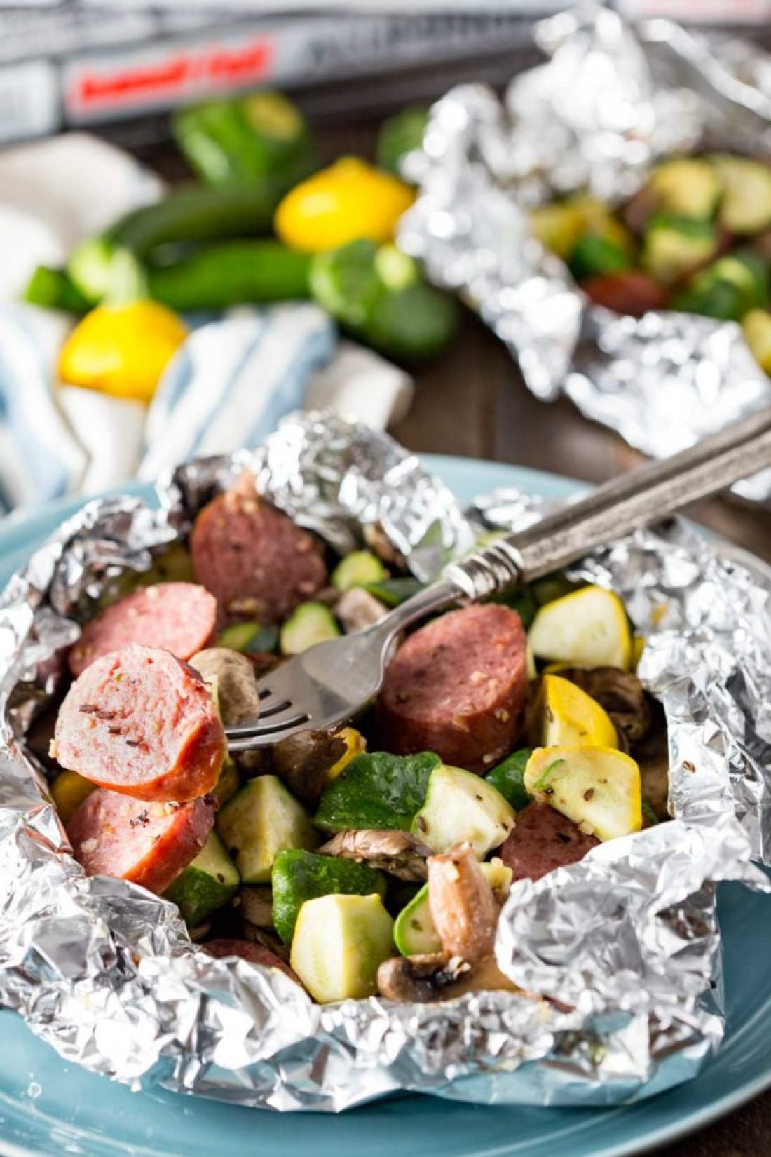 How to Cook Kielbasa in the Oven: Kielbasa sausage and fresh garden yellow squash and zucchini, and mushrooms, lightly seasoned, and cooked in Handi-Foil for the perfect, simple meal.