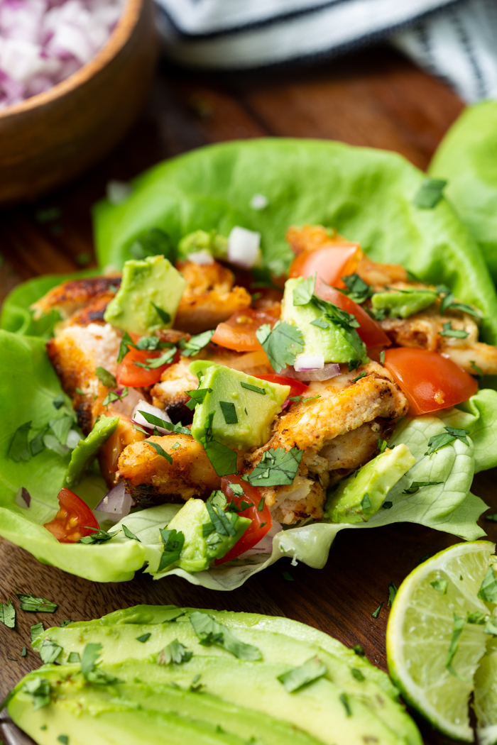 Chicken taco lettuce wraps on a cutting baord