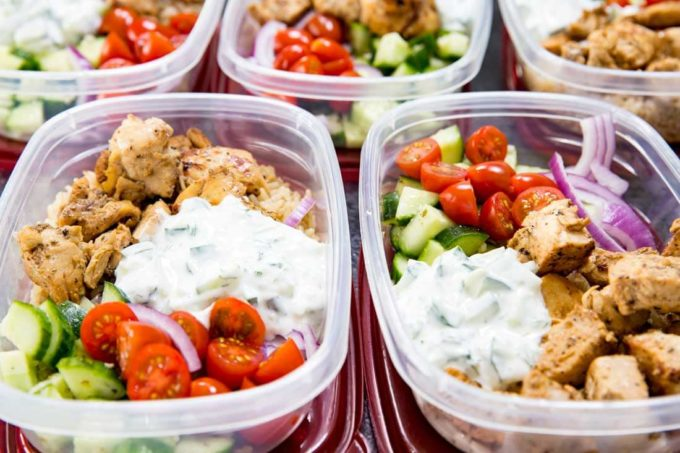 Greek Bowl: Insanely delicious Greek Chicken bowl recipes. Greek Marinated Chicken, cucumber salad, tzatziki, red onion, and tomato, served over brown rice. These are quick and easy to make, and will help you be set for the week.
