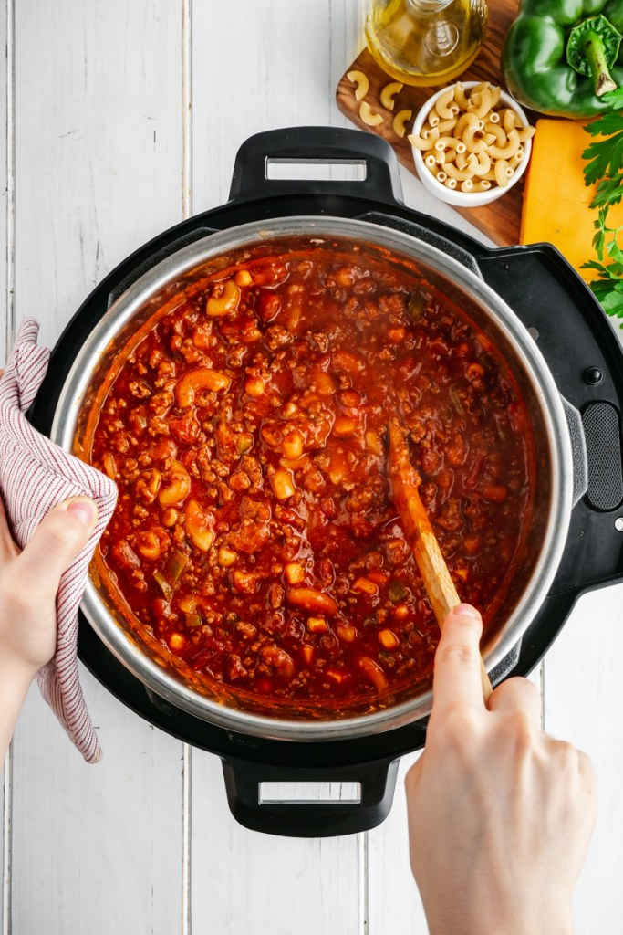 An instant pot with elbow macaroni in tomato sauce
