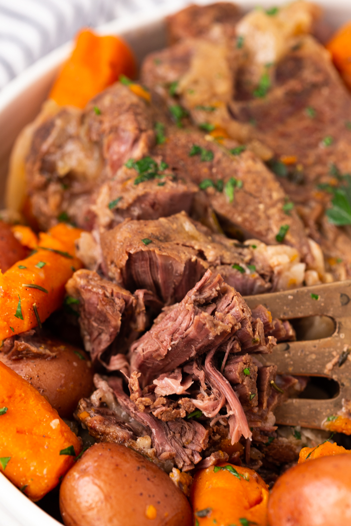 Instant Pot Pot Roast made from a chuck roast and cooked in a pressure cooker until nice and tender.