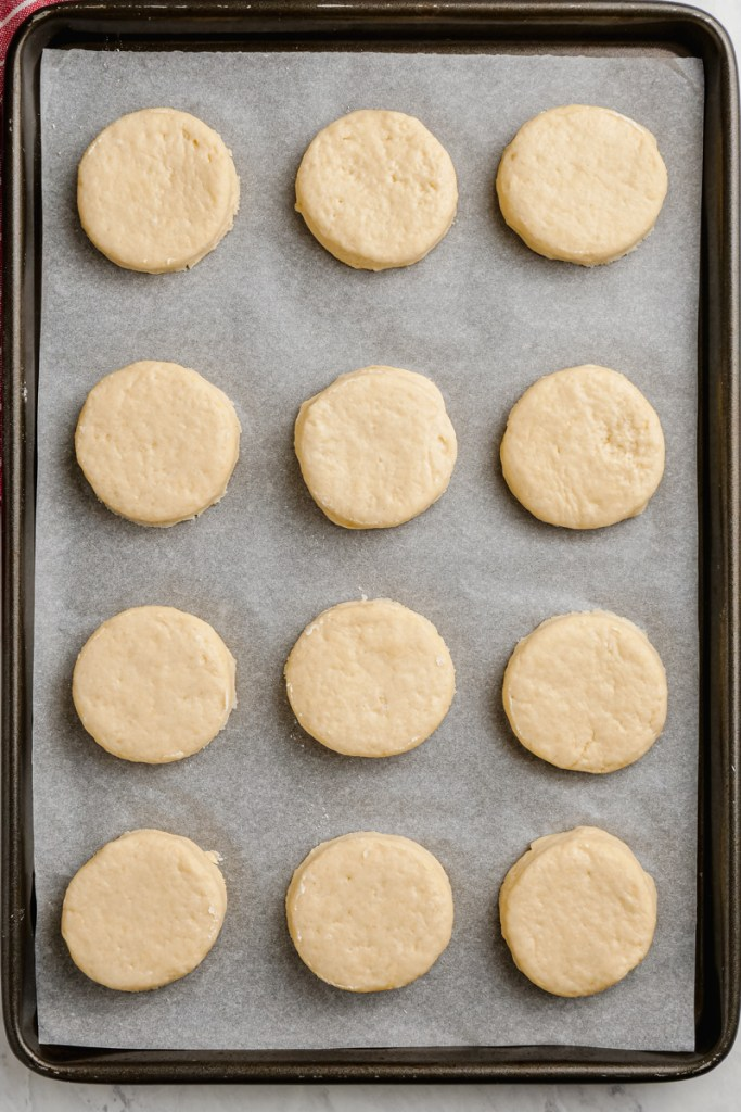 Biscuits rolled out, cut and put onto a pan for baking