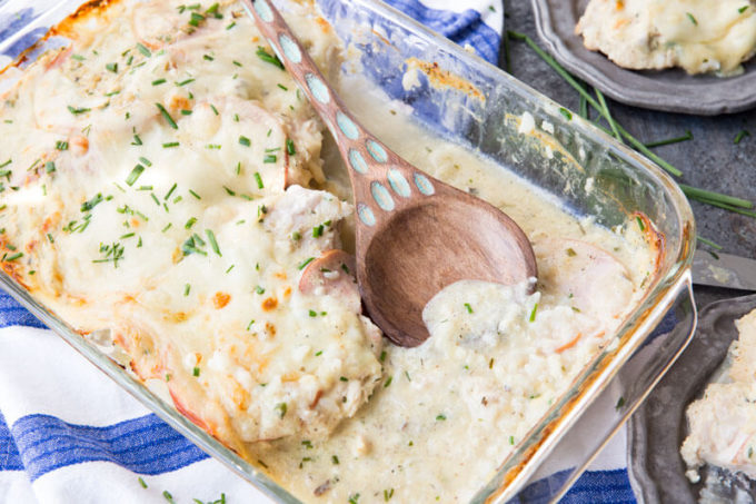 monte cristo chicken in baking dish with wood spoon