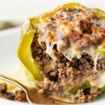 Philly cheese steak stuffed peppers on a white plate
