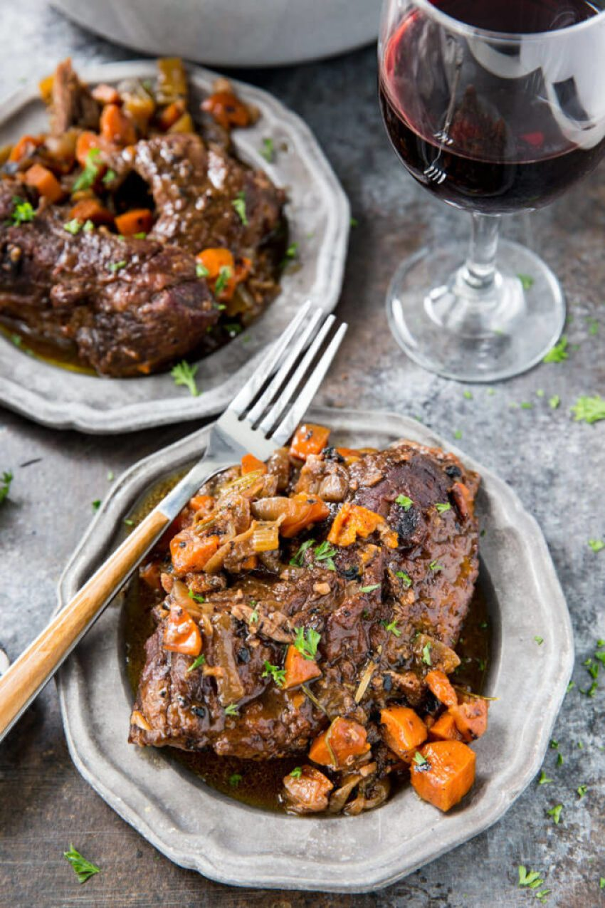 Red Wine Braised Beef: When cooked to perfection in a dutch oven, is fork tender and deliciously flavorful. There is just something about braising beef that makes it so amazing. Later this week I will share a tomato braised beef, but today I wanted to share this red wine braised beef. And it was not braised by just any