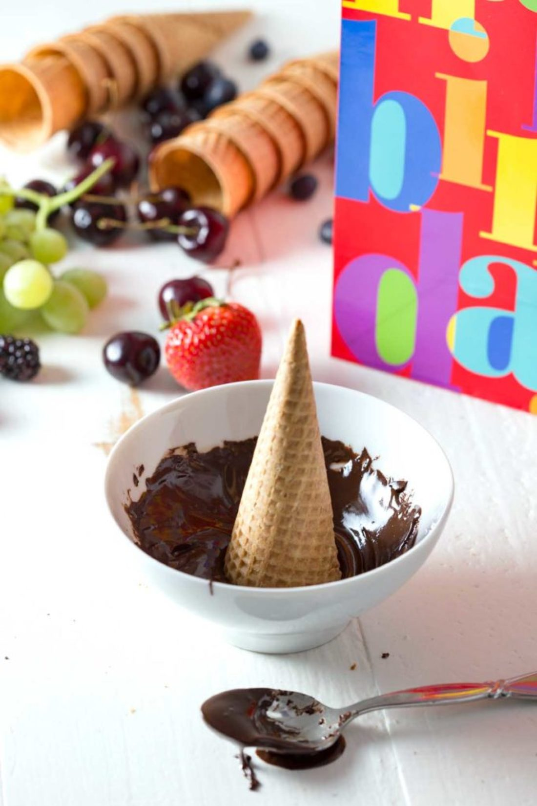 Dipping a cone in chocolate