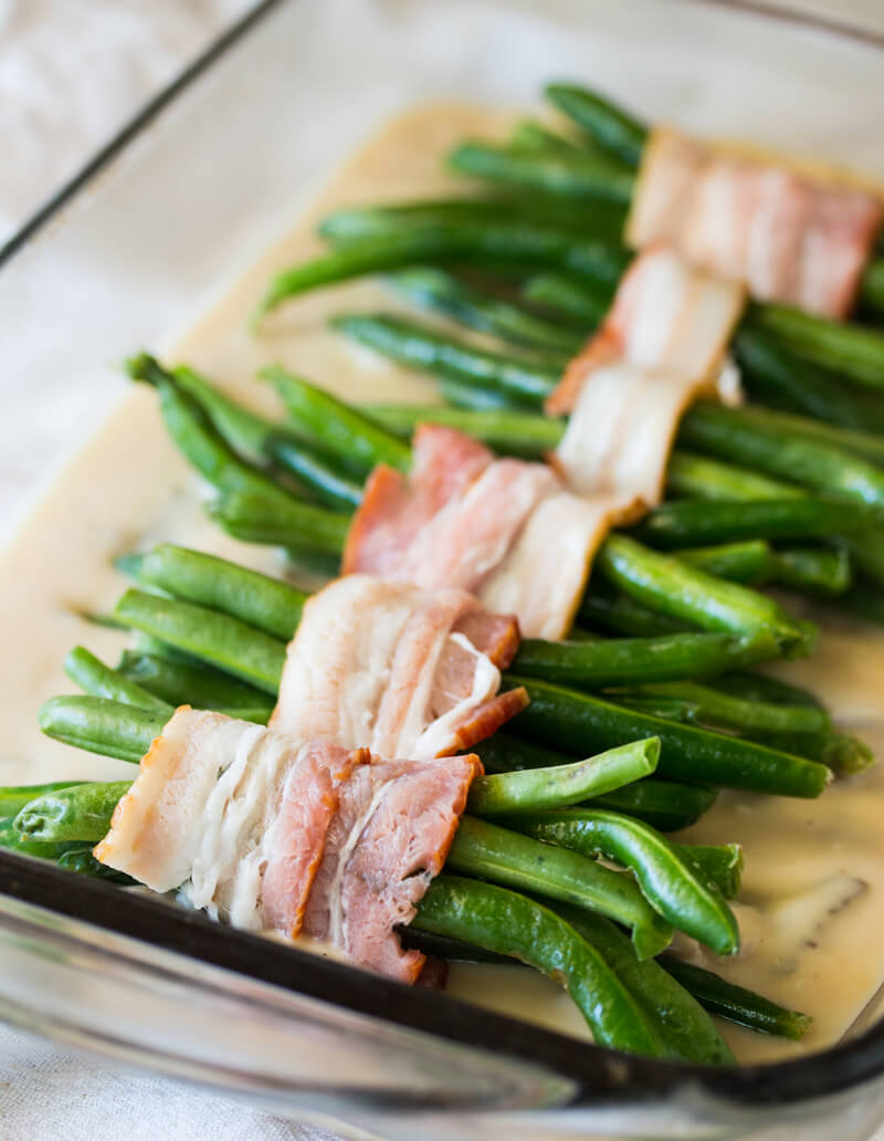 Creamy Green Beans and Mushrooms: Features tender green beans that are wrapped in bacon and baked atop a creamy delicious mushroom sauce. Umm good!