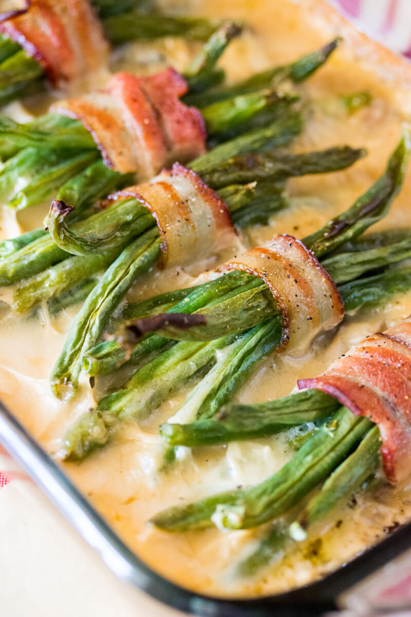 Green Beans and Cream of Mushroom: Features tender green beans that are wrapped in bacon and baked atop a creamy delicious mushroom sauce. Umm good!