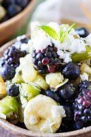 A pina colada fruit salad with beauty greens