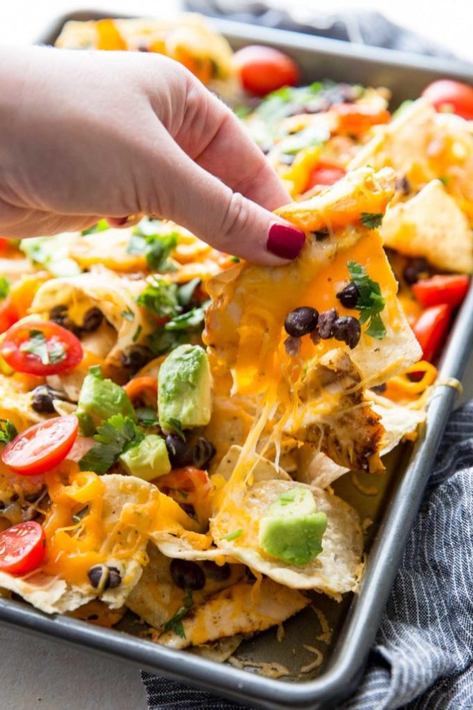 Chicken for Nachos: These nachos are ultra filling, easy to make, and are loaded with crunchy chips, melty cheese, flavorful chicken, and your favorite toppings!