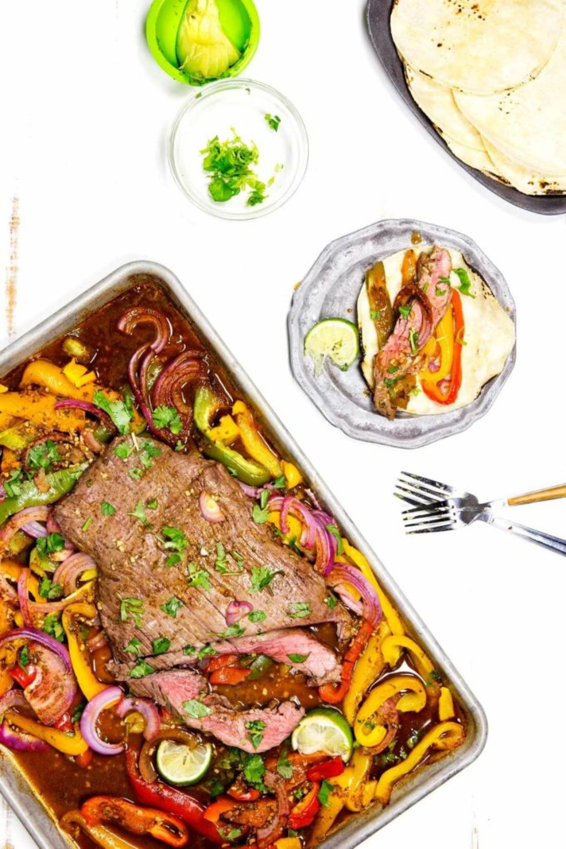 Fajitas cooked on a sheet pan, these flank steak fajitas are made with a marinade to die for!