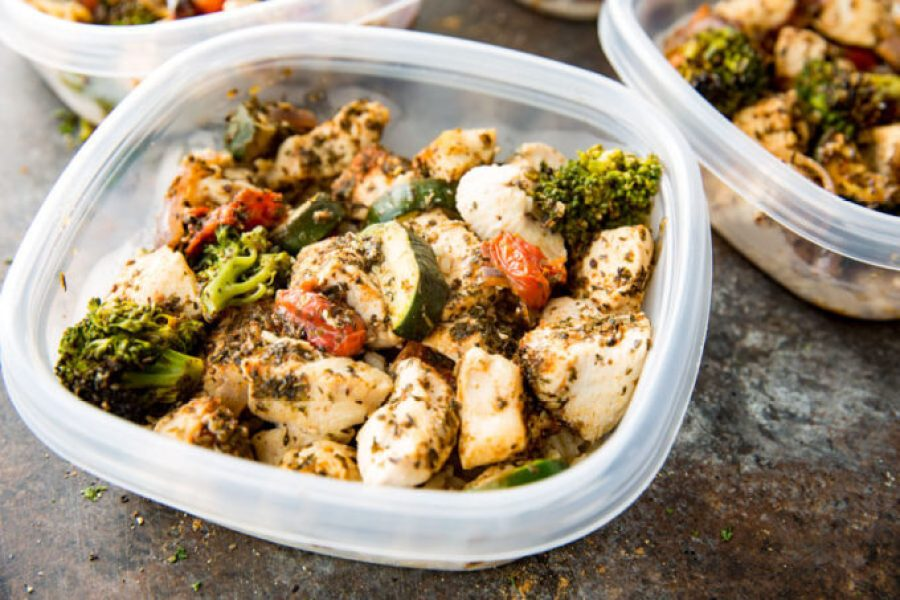 Chicken Meal Prep: Brown rice, zucchini, broccoli, tomatoes, onion and seasoned chicken, all cooked on a sheet pan for big flavor, meal prep!