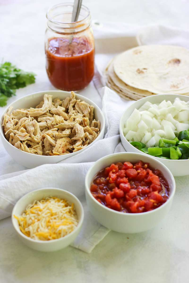 These Chicken Enchilada Meal Prep Bowls are perfect to spice your up meal prep for lunch or dinner!