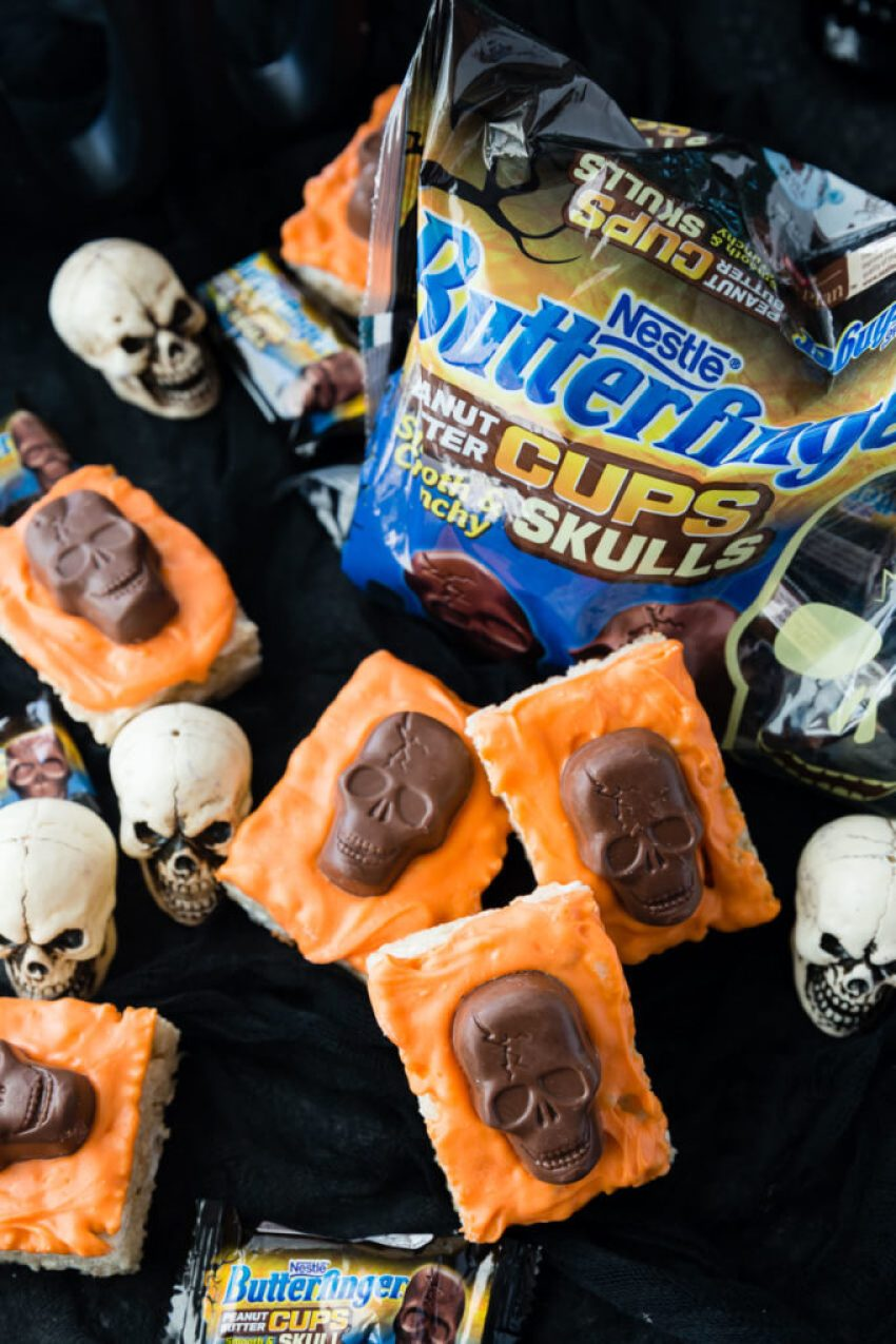 Deliciously easy to make Halloween Rice Krispie Treats with Butterfinger Peanut Butter Skulls