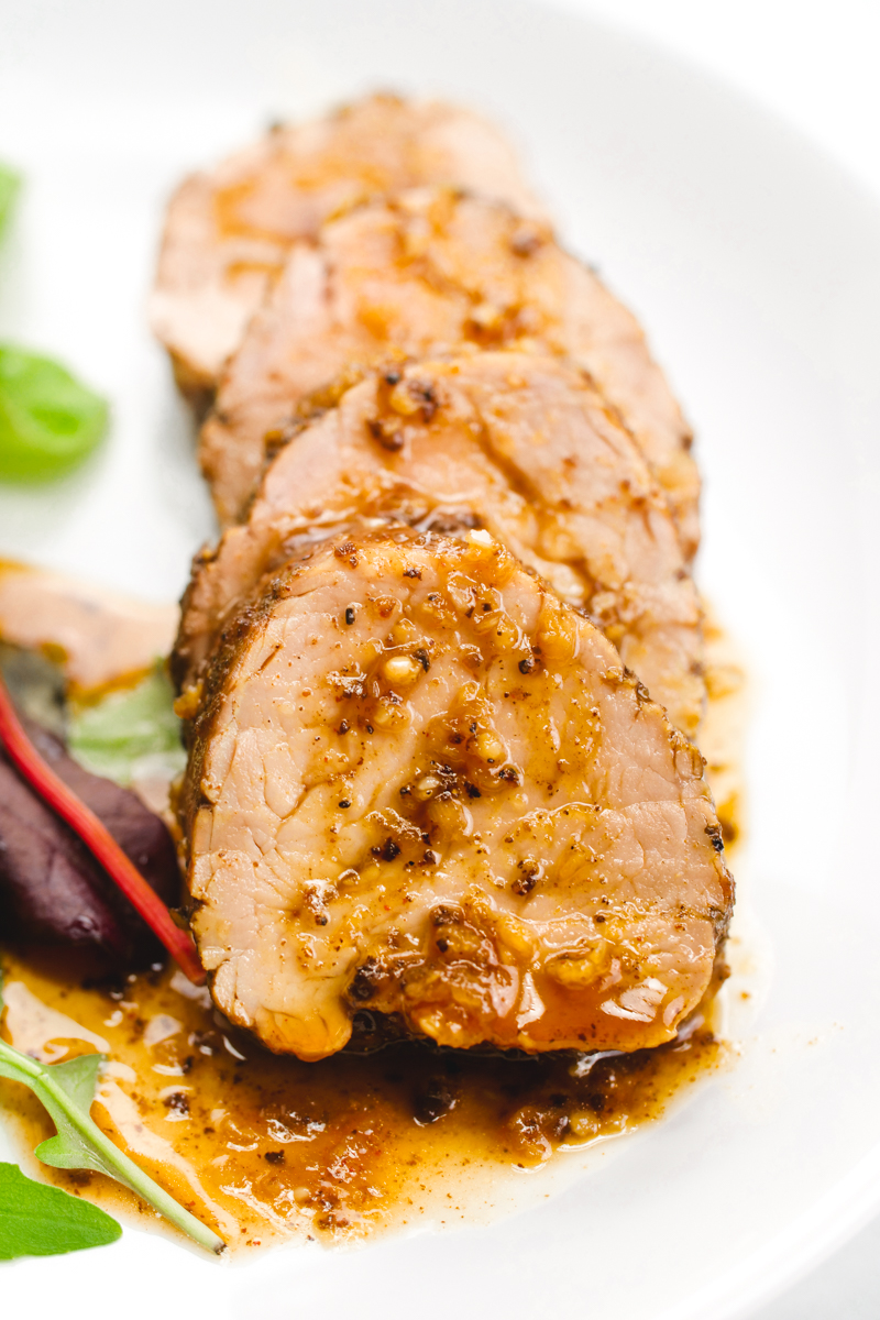 Island style pork tenderloin, rubbed with spices, and cooked in a delicious sauce for a tropical vacation for your tastebuds.