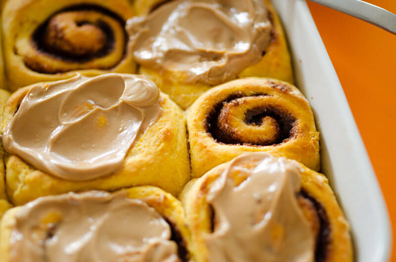 These Sweet Potato Cinnamon Rolls are decadent, fluffy, and slathered with a simple brown sugar frosting. Cozy up with a cup of tea and these cinnamon rolls for the perfect autumn morning!