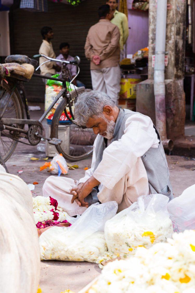 Flower vendor, praying