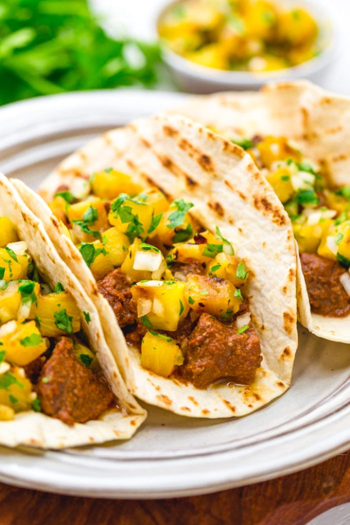 Tacos al pastor, richly flavorful pork al pastor tacos with a pineapple pico