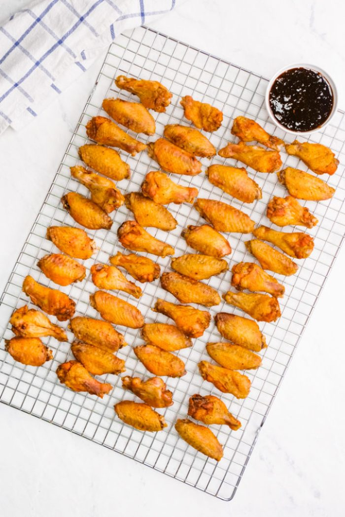 Oven baked and crispy wings on a cooling rack