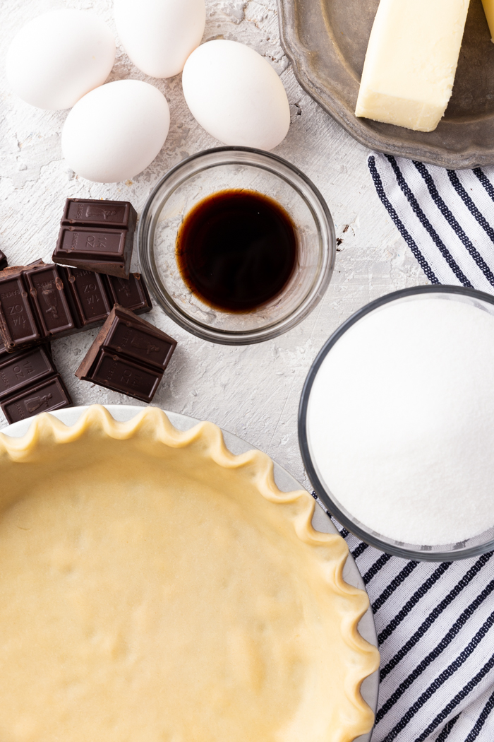 A delicious chocolate pie recipe with a crust, chocolate, and more.