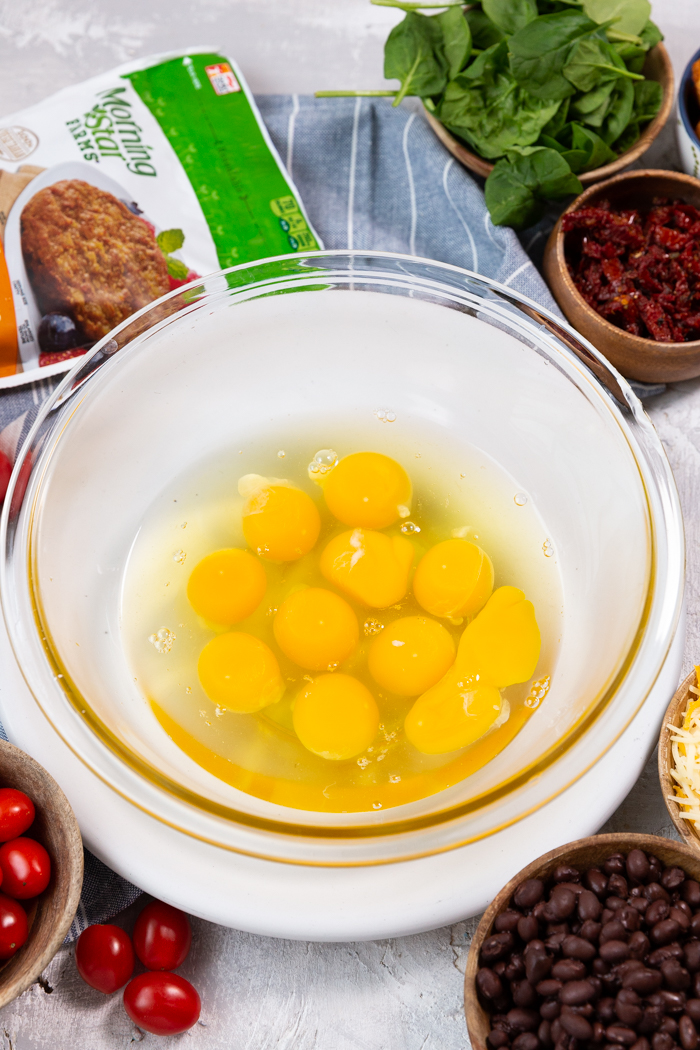 Eggs in a glass bowl for freezer breakfast burritos