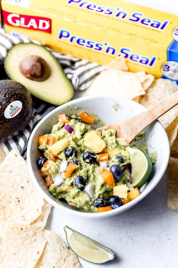A bowl of make your own guacamole with fun fruit mixins