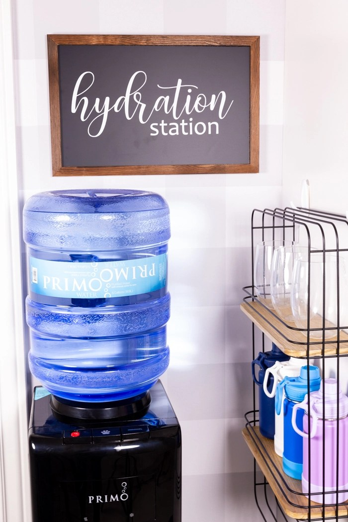 The hydration station, a water dispenser and shelf to hold bottles