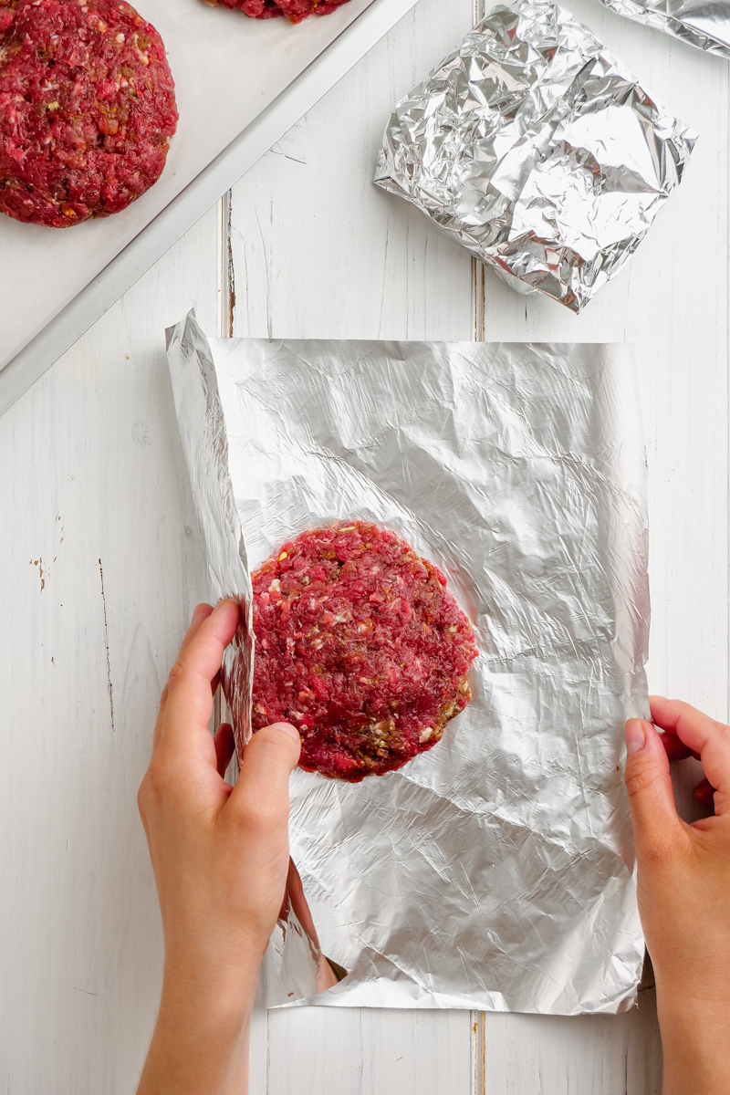 Wrapping hamburger patties with foil