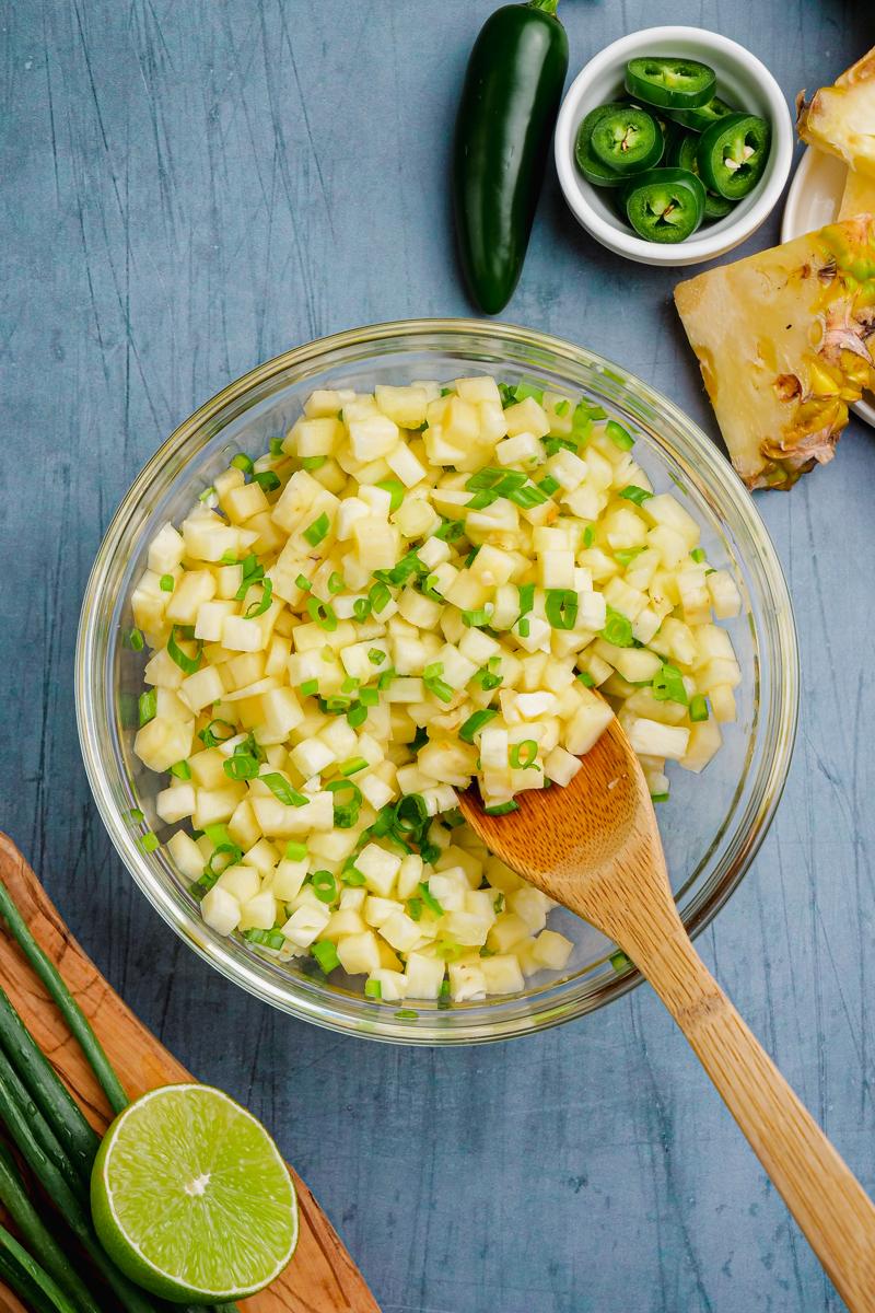 Making pineapple salsa for kalua pork