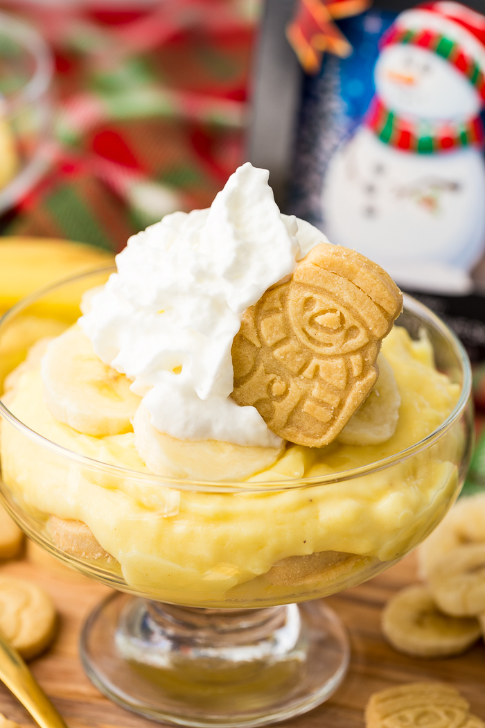 Holiday snowman walkers shortbread festive cookie on top of holiday banana pudding