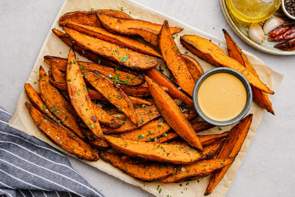 Sweet Potato Wedges on a tray with dipping sauces.