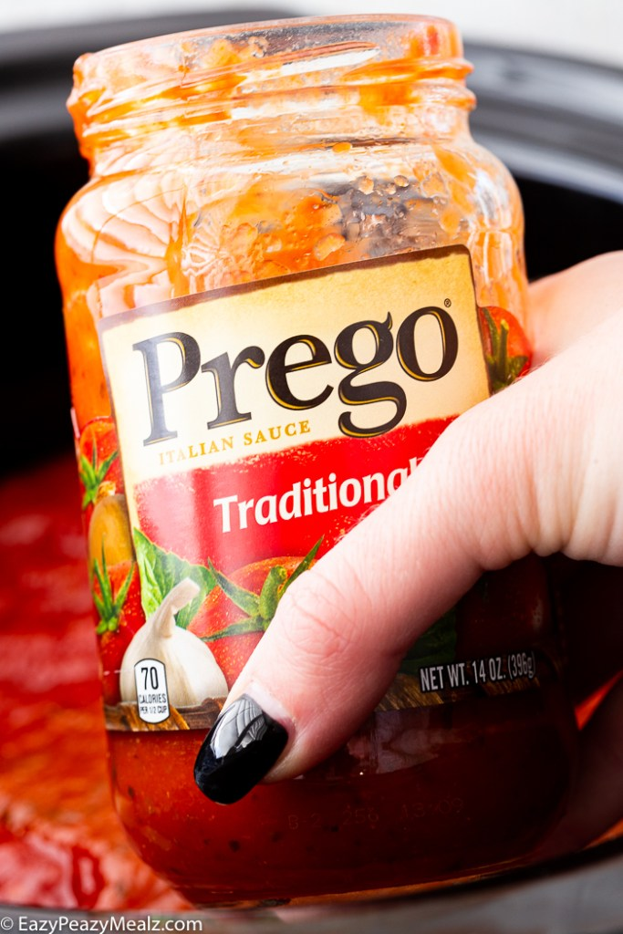 Adding more Prego sauce to the slow cooker