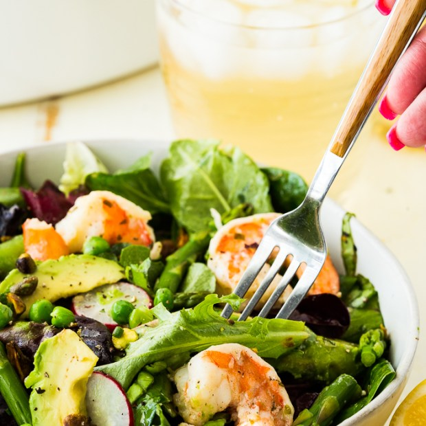 Citrus Shrimp Spring salad with a fork iced tea in background