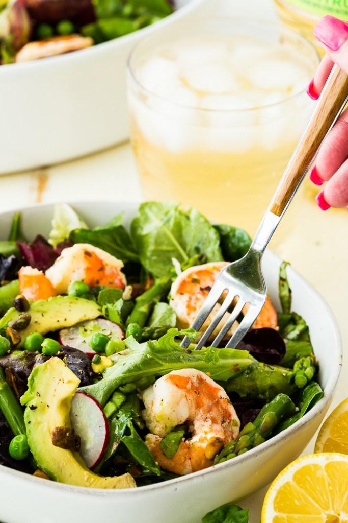 Citrus Shrimp Spring salad with a fork iced tea in background