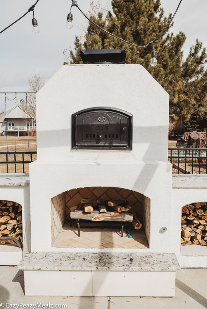 Round grove brick oven and fireplace combo