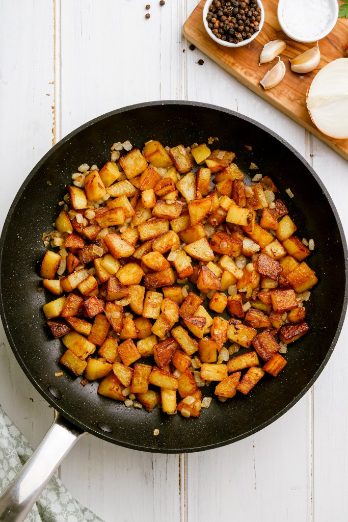 Home fries in a skillet, delicious golden potatoes