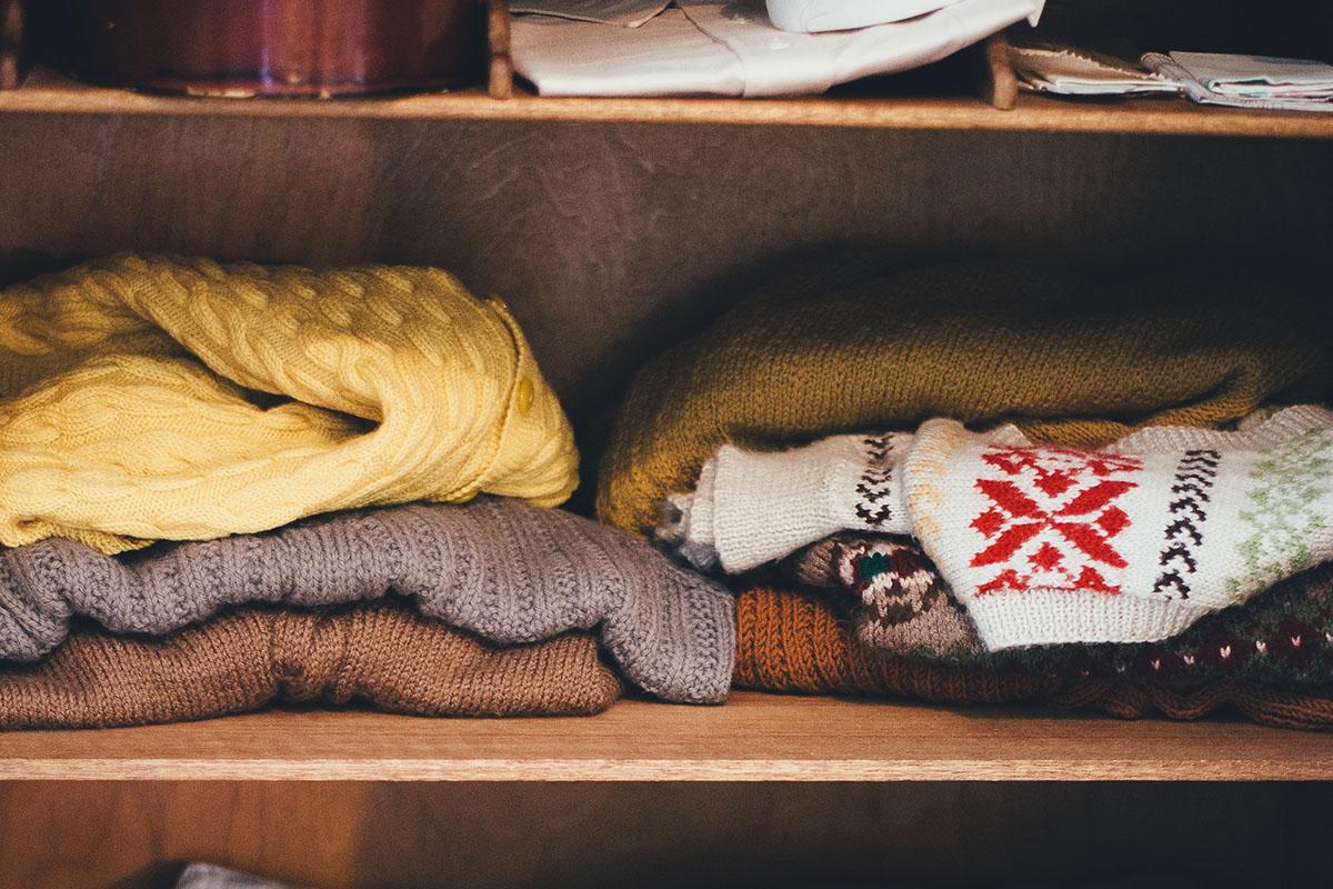 Sweaters in a closet