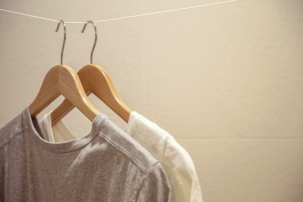 T-shirts on hangers in closet