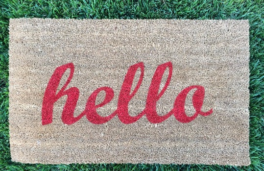 Etsy hello welcome mat in red and tan
