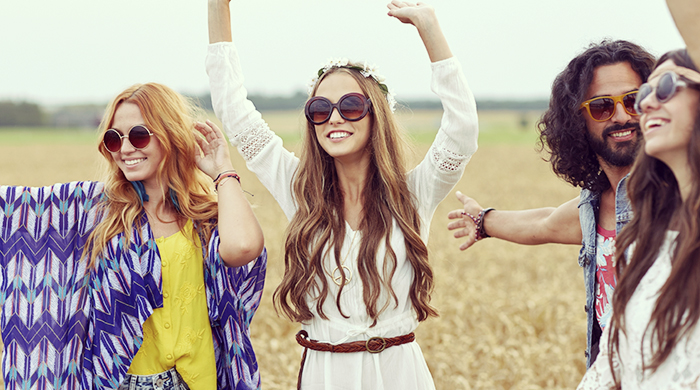 Happy young hippie friends at music festival