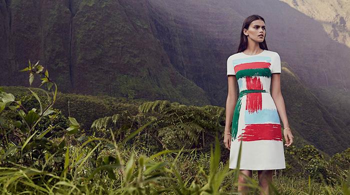 Woman wearing white dress next to mountains