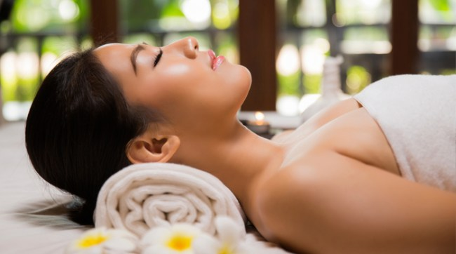 Woman getting a spa treatment with eyes closed and relaxed