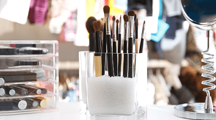 Makeup brushes in a clear container