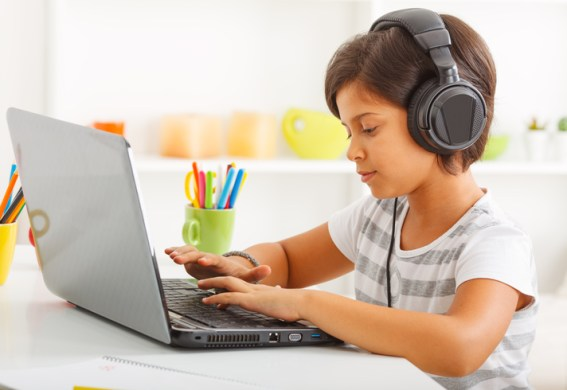 Young child working on laptop