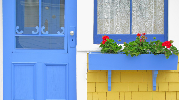 House with blue door and flower box