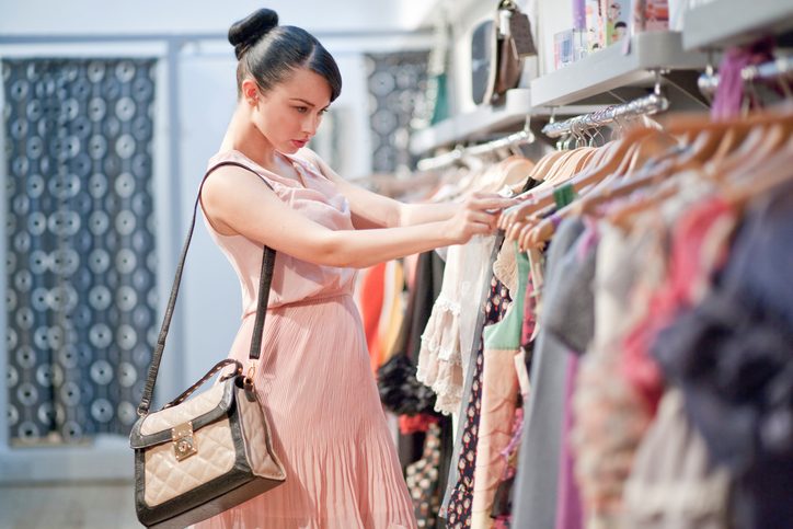 Woman browsing clothing racks
